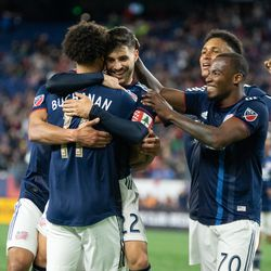 FOXBOROUGH, MA - MAY 11: New England Revolution midfielder Carles Gil #22 hugs forward Tajon Buchanan #11 after Buchanan provided the assist on Gil's second half goal at Gillette Stadium on May 11, 2019 in Foxborough, Massachusetts. (Photo by J. Alexander Dolan - The Bent Musket)