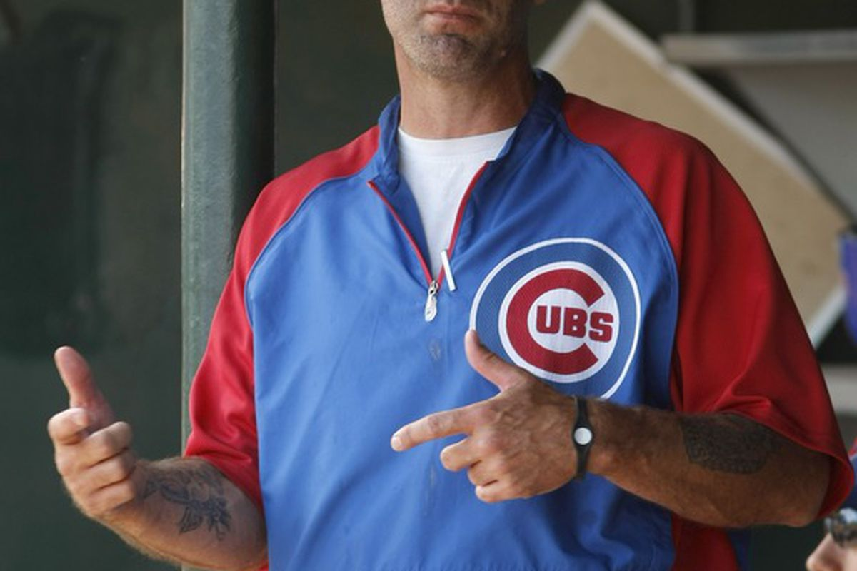 Scottsdale, AZ, USA; Chicago Cubs manager Dale Sveum in the dugout in the first inning against the Los Angeles Angels at Tempe Diablo Stadium. Credit: Rick Scuteri-US PRESSWIRE