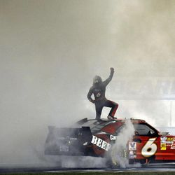 Ricky Stenhouse Jr. celebrates on his car after winning the NASCAR Nationwide Series auto race at Atlanta Motor Speedway, Saturday, Sept. 1, 2012, in Hampton, Ga.