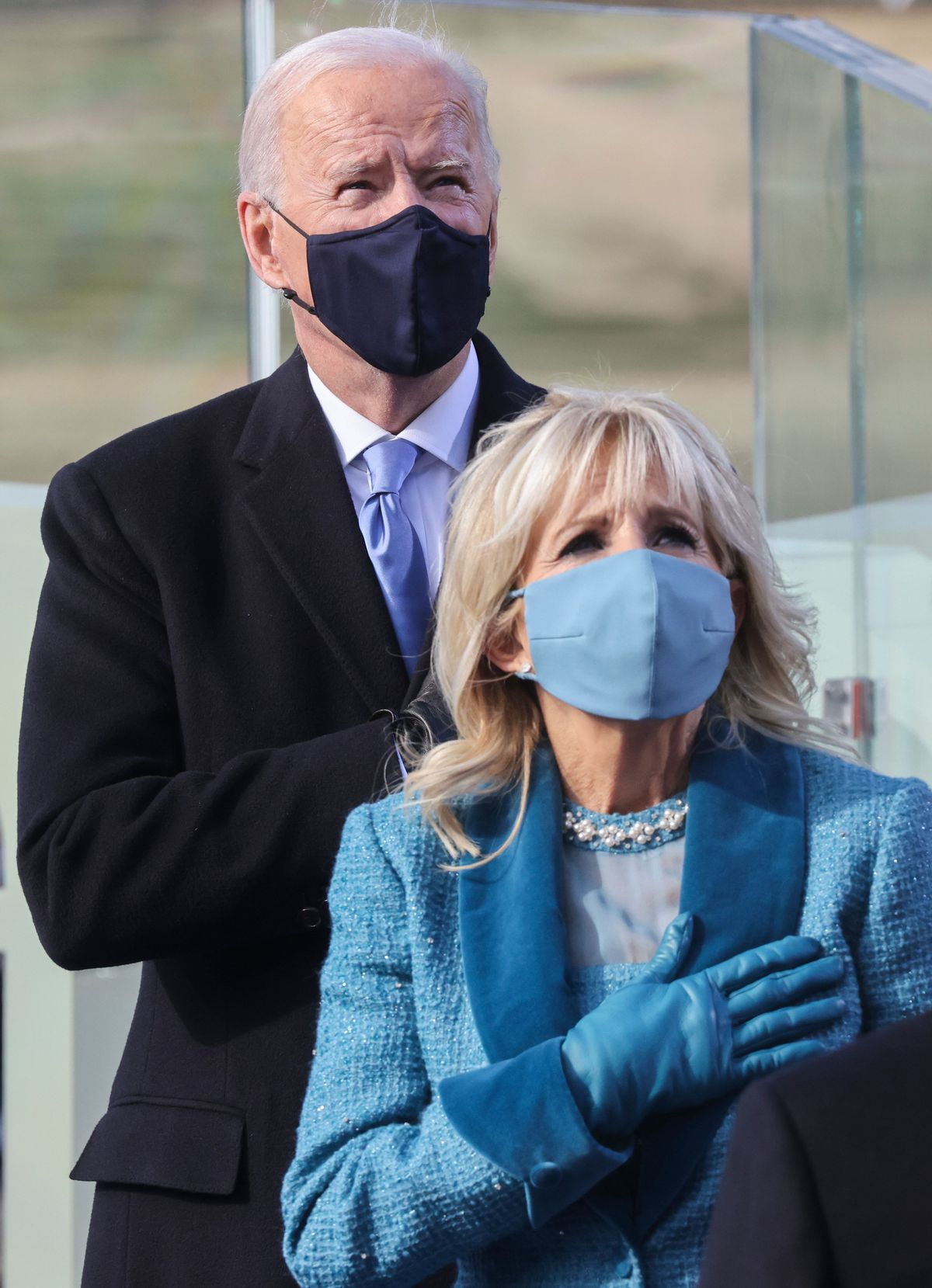 Joe Biden and his wife Jill Biden listen to the Pledge of Allegiance before he is sworn in as the 46th president of the United States on Wednesday.