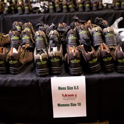 Hundreds of pairs of boots await new owners at the Rescue Mission of Salt Lake in Salt Lake City on Saturday, Dec. 19, 2020. Volunteers handed out hundreds of pairs of boots as well as hot meals to people experiencing homelessness.
