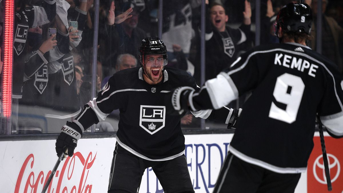 Oct 14, 2021; Los Angeles, California, USA; Los Angeles Kings center Anze Kopitar (11) celebrates with right wing Adrian Kempe (9) after scoring a goal during the second period against the Vegas Golden Knights at Staples Center.