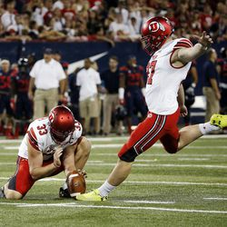 Utah Utes place-kicker Matt Gay kicks a field goal with Utah Utes punter Mitch Wishnowsky holding against Arizona in Tucson, Arizona, on Friday, Sept. 22, 2017. Utah beat Arizona 30-24.