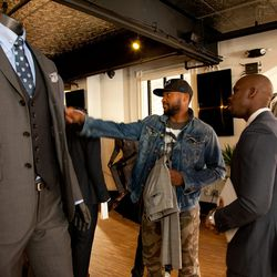 Washington Capitals player Joel Ward shops for suits with Marlon Thompson, Indochino's senior manager for retail operations.