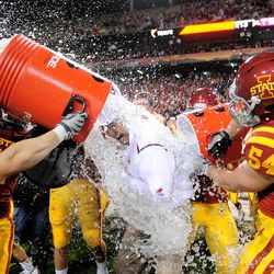 Iowa State Cyclones head coach Paul Rhoads is doused with water following the game against the Minnesota Golden Gophers in the 2009 Insight Bowl at Sun Devil Stadium.