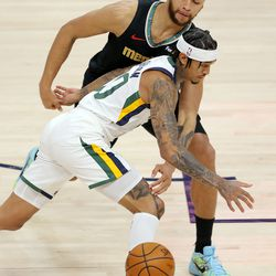 Memphis Grizzlies forward Kyle Anderson (1) knocks the ball away from Utah Jazz guard Jordan Clarkson (00) as the Utah Jazz and the Memphis Grizzlies play in game one of their NBA playoff series at Vivint Arena in Salt Lake City on Sunday, May 23, 2021.