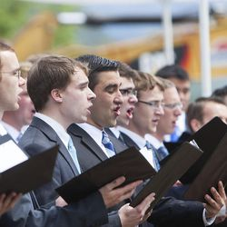 """A combined BYU men's choir sings """"High on the Mountain Top"""" during the groundbreaking ceremony for a new engineering building in Provo on Monday, May 9, 2016. The new building was entirely funded by donors."""