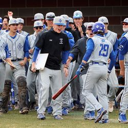 Bingham's Luke Orullian is welcomed by teammates after scoring a run as Layton and Bingham play a baseball game in Layton on Tuesday, March 23, 2021.