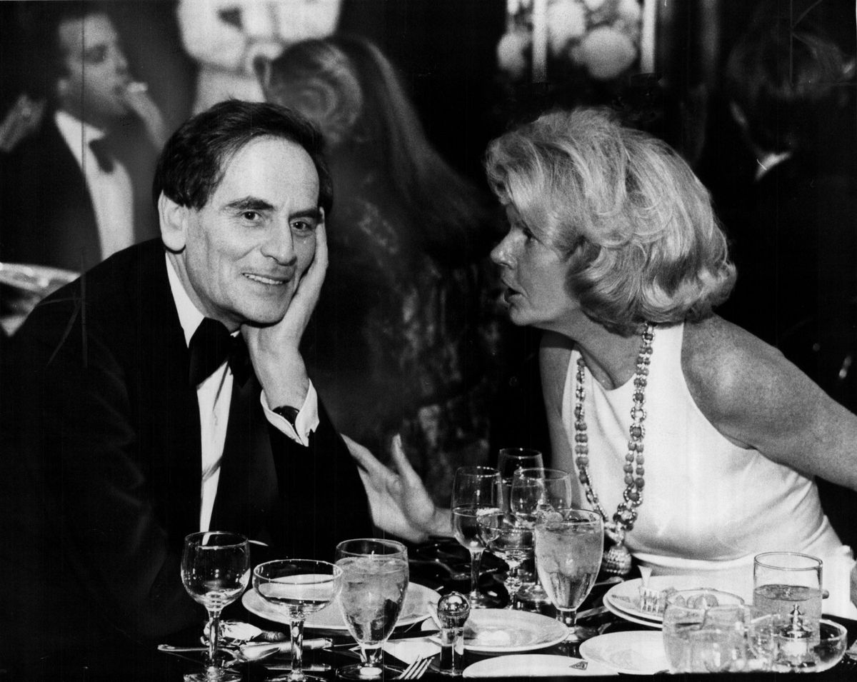 Fashion designer Pierre Cardin listening as Bonnie Swearingen expounds on the vitality of Chicago life at a party in 1976.