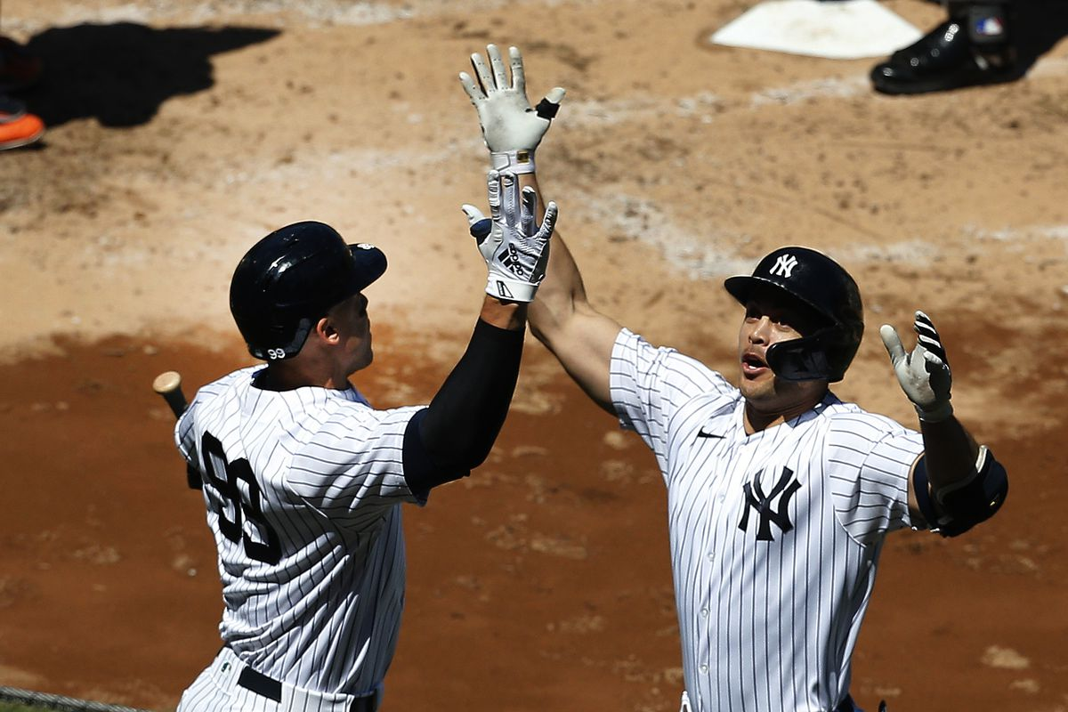 New York Yankees designated hitter Giancarlo Stanton is congratulated by right fielder Aaron Judge after hitting a solo home run against the Houston Astros during the third inning at Yankee Stadium.
