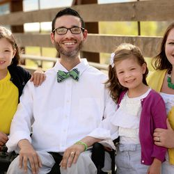 Vance Taylor poses with his wife Casey, right, and their daughters Isabelle, left, and Sammy.