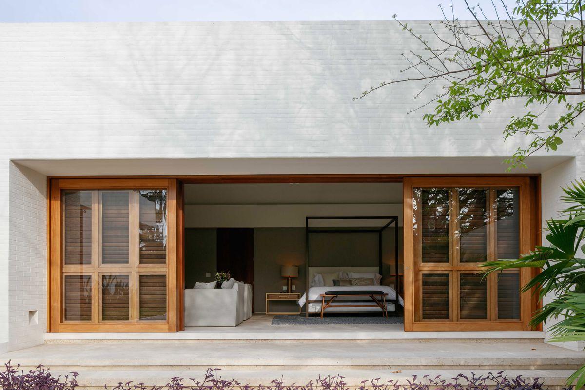 Bedroom with open sliding doors