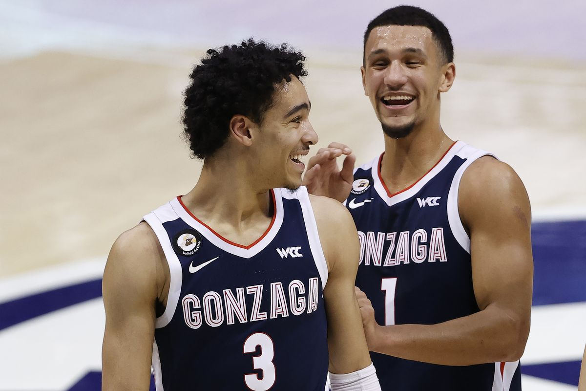 Gonzaga Bulldogs guard Jalen Suggs reacts with teammate, guard Andrew Nembhard after their win against the Brigham Young Cougars at Marriott Center.