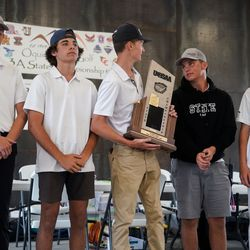Morgan High School receives the champion's trophy in the 3A boys state championship at Oquirrh Hills Golf Course in Tooele on Thursday, Oct. 7, 2021.