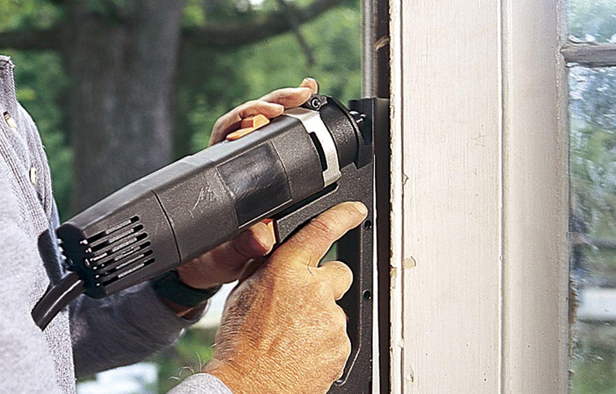 Person applying a door gap filler.