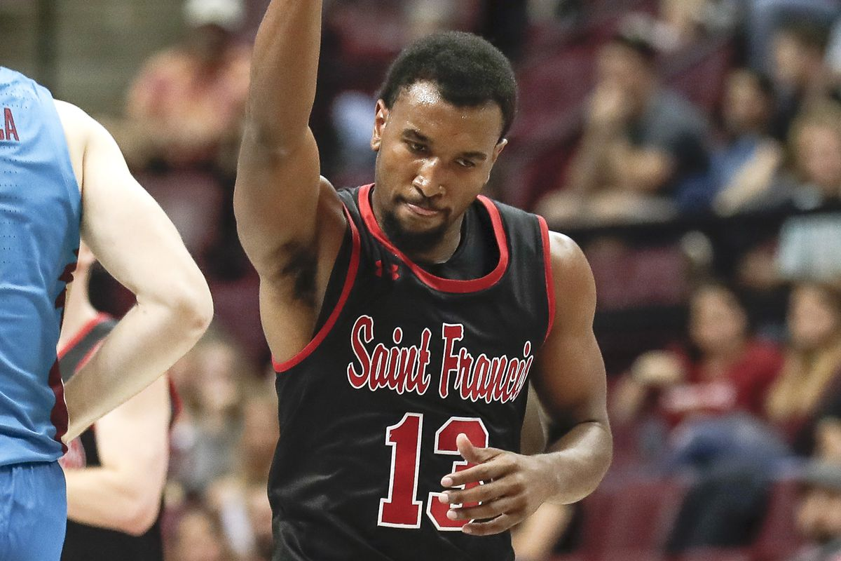 Keith Braxton of the Saint Francis Red Flash celebrates after making a 3-point shot during the game against the Florida State Seminoles at the Donald L. Tucker Center on November 23, 2019 in Tallahassee, Florida. The Seminoles defeated the Red Flash 80-65.