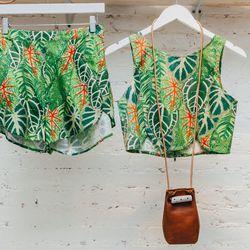 <b>Samantha Pleet</b> high-waisted shorts, $155 and crop top, $125; <b>Jujumade</b> pouch, $220