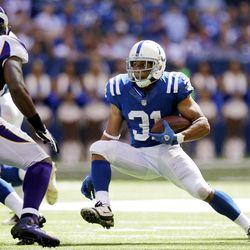 Indianapolis Colts' Donald Brown (31) runs against Minnesota Vikings' Jasper Brinkley (54) during the second half of an NFL football game in Indianapolis, Sunday, Sept. 16, 2012.