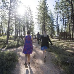 Gabi Sheeley, Eric Meeks, Meleeza Hall and Amy Auble walk to the outdoor amphitheater for the 9:30 a.m. nondenominational Christian church service in Bryce Canyon National Park, Sunday, June 18, 2017.