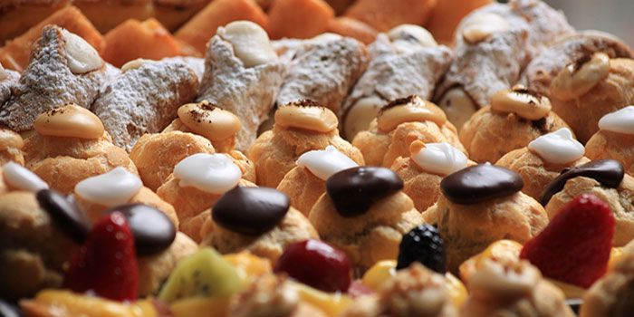 Rows of brightly covered pastries