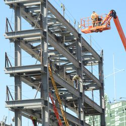 3:06 p.m. Working on the top of the right-field video board structure -