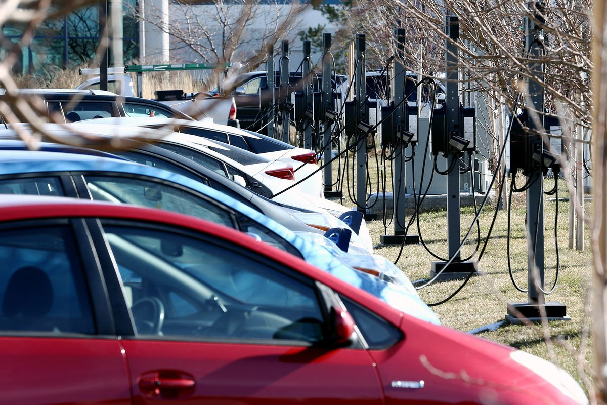 Electric cars are parked at charging stations as Packsize International in Salt Lake City becomes the largest electric vehicle charger installation in Utah on Tuesday, Dec. 19, 2017.