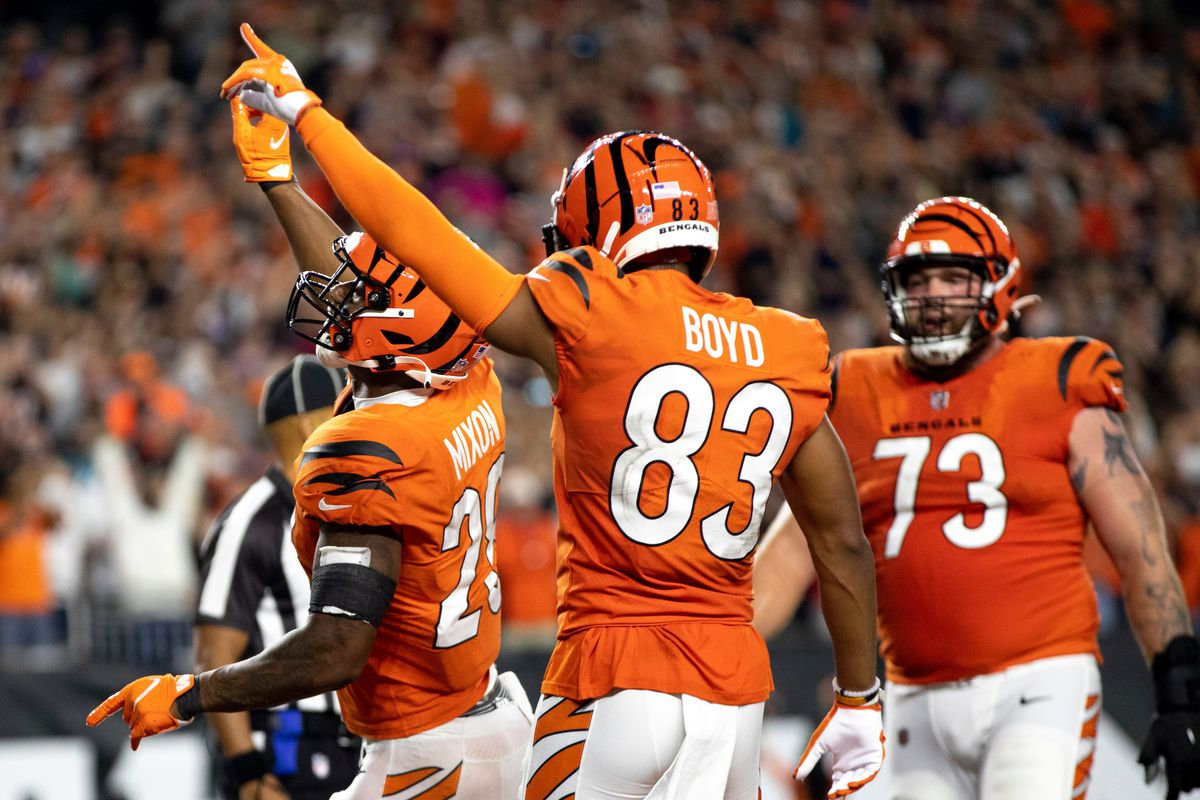 Cincinnati Bengals running back Joe Mixon (28) celebrates with Cincinnati Bengals wide receiver Tyler Boyd (83) after scoring a touchdown in the second half of the NFL football game on Thursday, Sept. 30, 2021, at Paul Brown Stadium in Cincinnati.