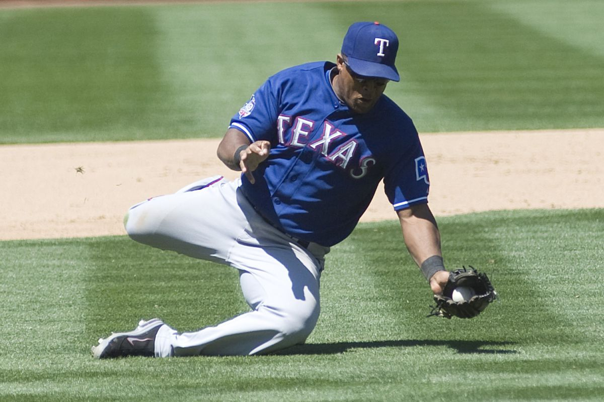 July 18, 2012; Oakland, CA, USA; Texas Rangers third baseman Adrian Beltre (29) makes a diving catch in the infield against the Oakland Athletics at O.co Coliseum.  Mandatory Credit: Ed Szczepanski-US PRESSWIRE