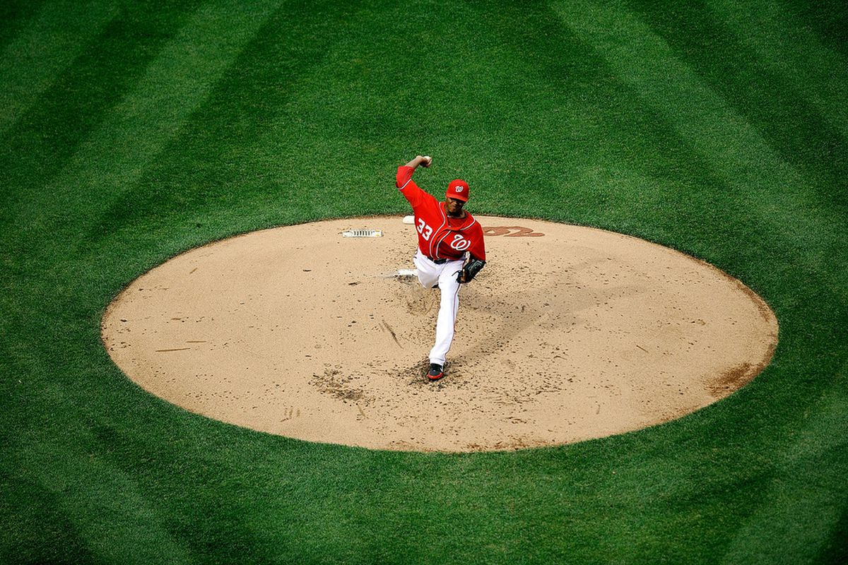 WASHINGTON, DC - APRIL 14:  Edwin Jackson #33 of the Washington Nationals throws a pitch against the Cincinnati Reds at Nationals Park on April 14, 2012 in Washington, DC.  (Photo by Patrick McDermott/Getty Images)