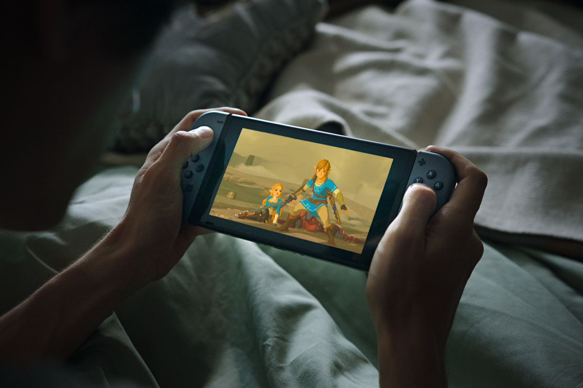 playing Zelda on the Switch in bed