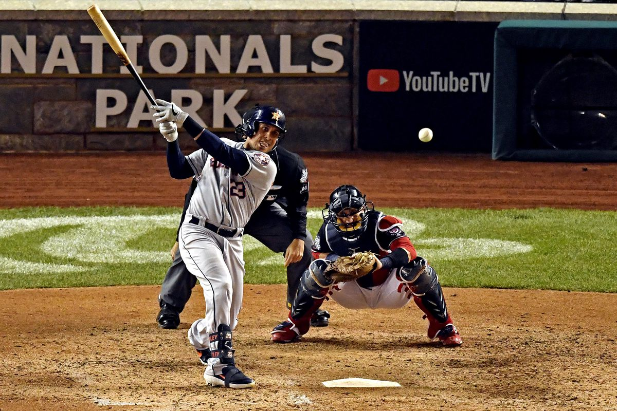 Houston Astros left fielder Michael Brantley hits a single during the seventh inning against the Washington Nationals in game four of the 2019 World Series at Nationals Park.
