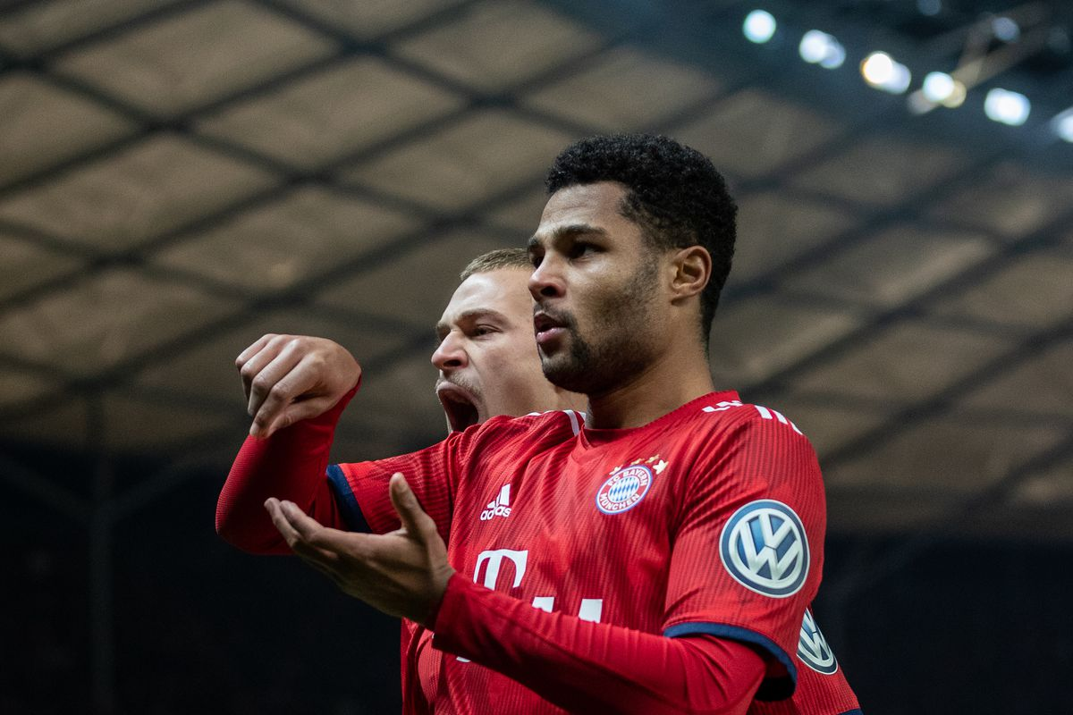 BERLIN, GERMANY - FEBRUARY 06: Serge Gnabry of FC Bayern Muenchen celebrates with team mates after scoring his team's second goal during the DFB Cup match between Hertha BSC and FC Bayern Muenchen at Olympiastadion on February 06, 2019 in Berlin, Germany.