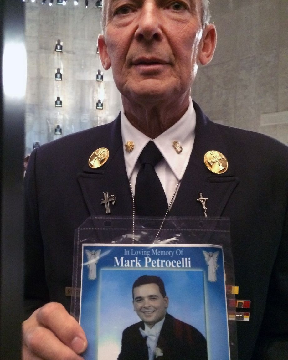 Former FDNY member Albert Petrocelli wears a tribute to his son, who died in 9/11, during the papal visit in 2015.