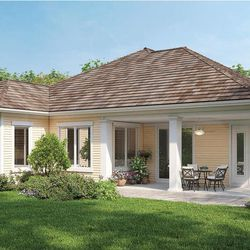 In this rendering released by Homeplans.com, House of the Week HMAFAPW1710 shows the back of a compact luxury home with shingles, siding, and a rear lanai that add country flavor to the exterior of this thoughtfully designed home.