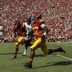 Southern California running back Curtis McNeal, center, runs with the ball during the first half of an NCAA college football game against California in Los Angeles, Saturday, Sept. 22, 2012.