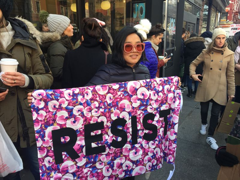 Eunice Kim with a banner from the Protest Banner Lending Library at the women's march in New York City