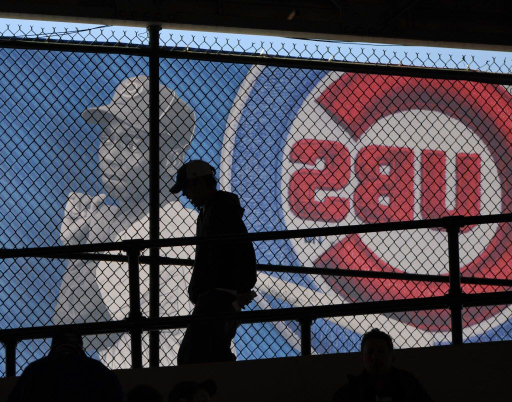 A fan walks down the ramp in front of a mural of Ernie Banks in the second inning of the Chicago Cubs 7-4 loss to the Milwaukee Brewers in the Cubs home opener Monday April 8, 2013 at the Wrigley Field.   Sun-Times library