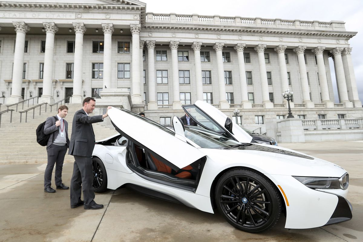 Rep. Mike Winder, R-West Valley City, gets a look at a BMW i8 plug-in hybrid vehicle outside the Capitol during Clean Energy Business Day at the Legislature in Salt Lake City on Wednesday, March 6, 2019. Twelve Utah based companies were at the Capitol to