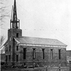 The St. George Tabernacle as it looked while under construction in the 1860s.