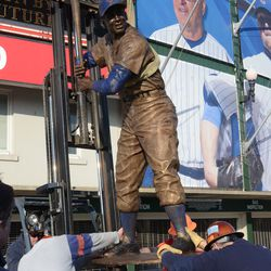5:27 p.m. The statue being lowered into position -