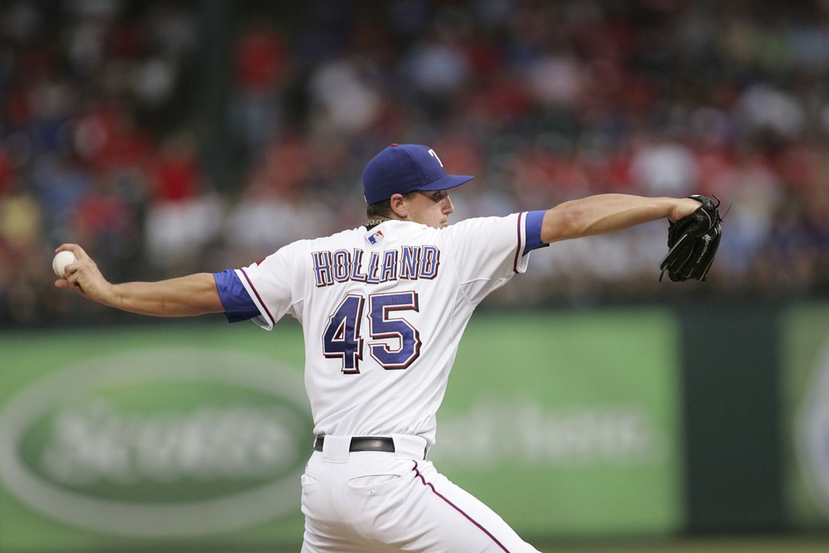 ARLINGTON, TX - JUNE 20: Derek Holland #45 of the Texas Rangers pitches against the Houston Astros at Rangers Ballpark in Arlington on June 20, 2011 in Arlington, Texas.  (Photo by Rick Yeatts/Getty Images)