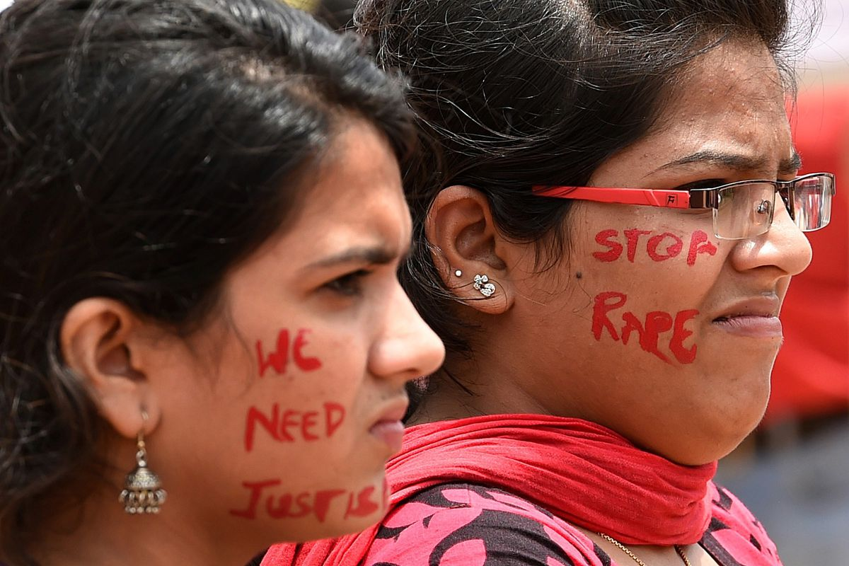 """Indian activists participate in a rally organized by """"The Red Brigade — Bring Bangalore Back"""" to protest against the recent incidents of sexual abuse, molestation, and rapes against women in Bangalore on July 20, 2014."""