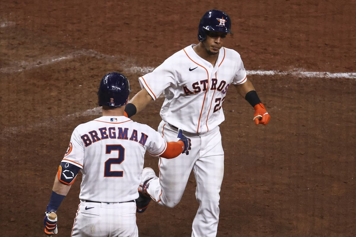 Houston Astros left fielder Michael Brantley celebrates with third baseman Alex Bregman after hitting a home run during the eighth inning against the Detroit Tigers at Minute Maid Park.
