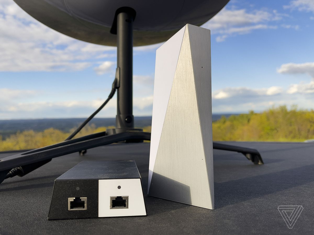 The Starlink power adapter and Wi-Fi router