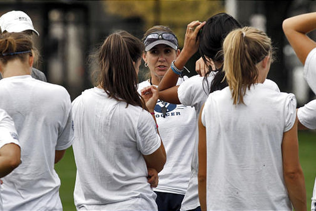 BYU soccer coach Jennifer Rockwood, center, addresses her team during a break at practice. The Cougars have a young team but high expectations.