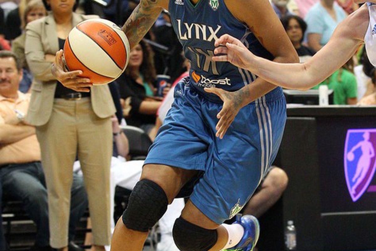 June 23, 2012; Minneapolis, MN, USA: Minnesota Lynx forward Seimone Augustus (33) drives to the basket against the Chicago Sky at Target Center. The Lynx won 79-67. Mandatory Credit: Jesse Johnson-US PRESSWIRE