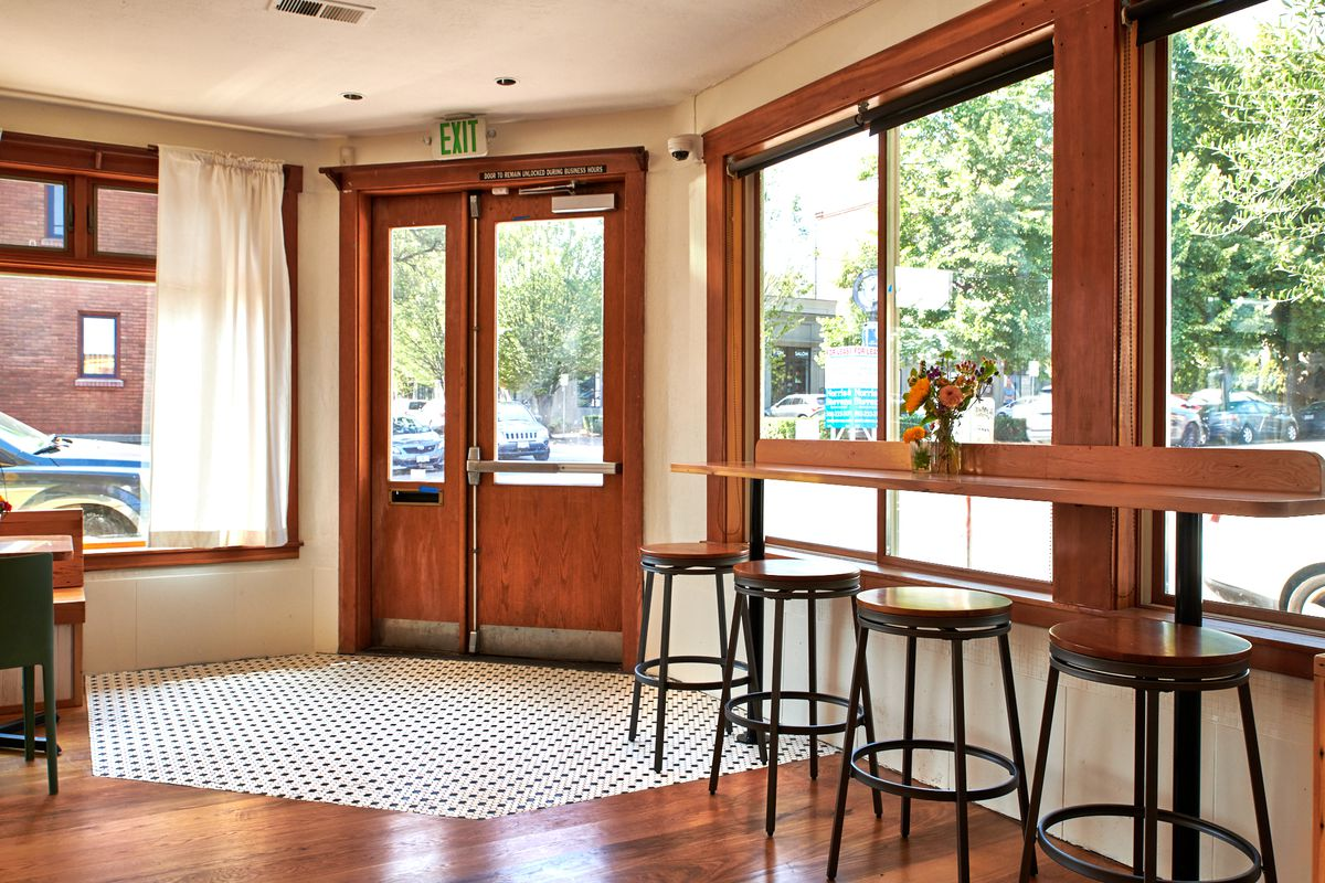 Along the windows, a small wooden bar looks out on Northwest Portland