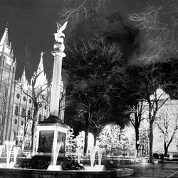 The seagull monument and Temple are aglow in December 1966, the second year of lights on Temple Square.