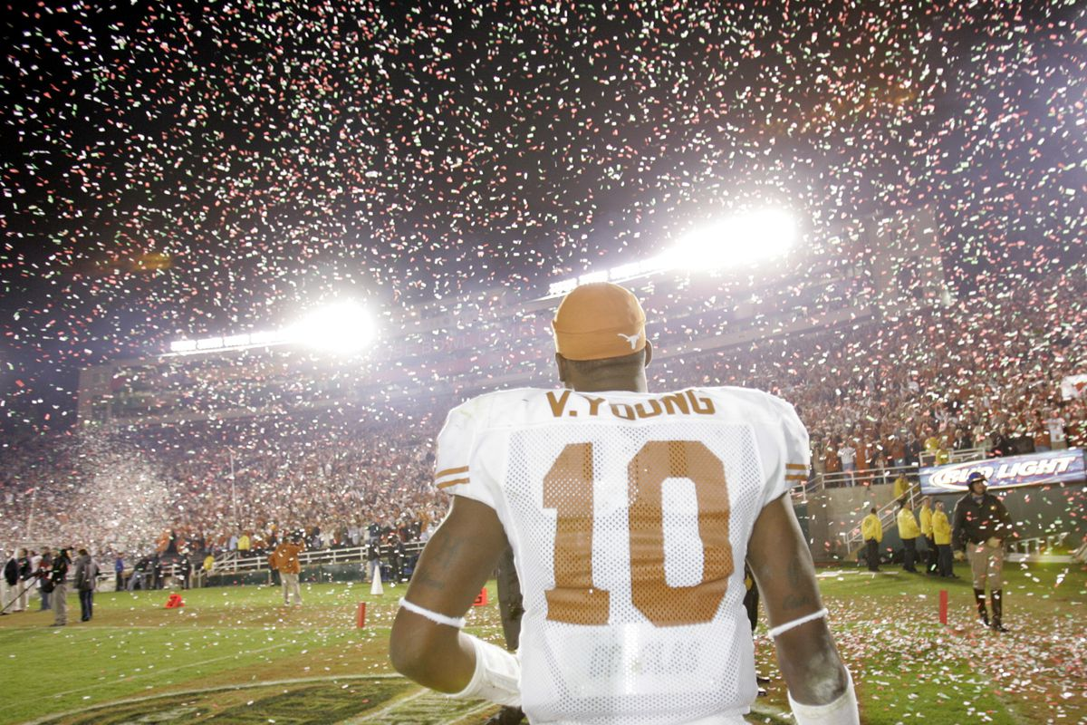 Texas Longhorns quarterback Vince Young walks off the confetti–covered Rose Bowl after Texas defeat