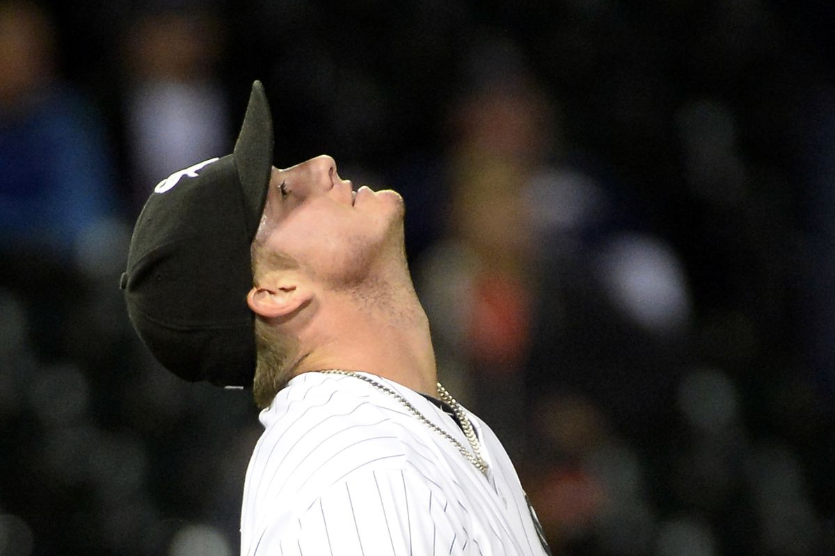Addison Reed, shown looking at his salary curve.